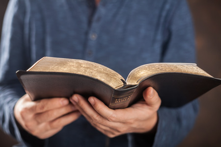 Man reading from the holy bible, close up Banco de Imagens