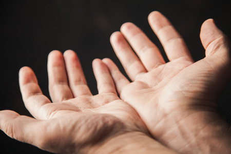 hands begging on a brown background photo