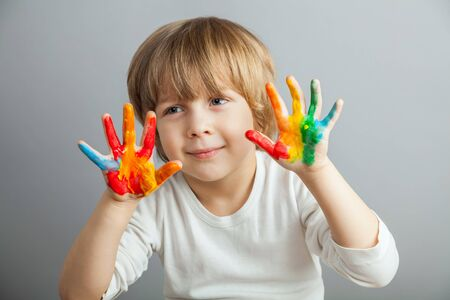 little girl and boy hands painted  in colorful paints Stock Photo - 37489042