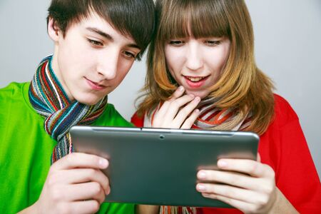 Boy and girl enjoying new tablet. photo