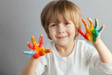 little girl and boy hands painted  in colorful paints photo