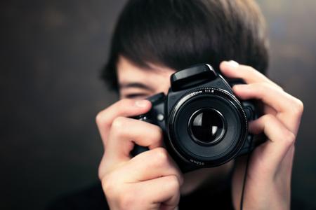 compact camera: Teenager with digital compact camera