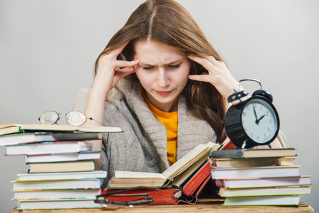 crazy girl: funny crazy  girl student with glasses reading books Stock Photo