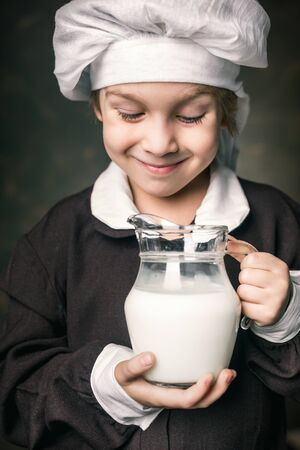 milkman boy holding a glass of milk photo
