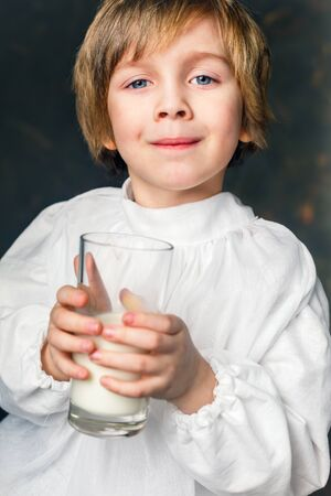milkman boy holding a glass of milk Stock Photo - 39075745