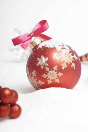 Christmas ball with red bow and ribbon