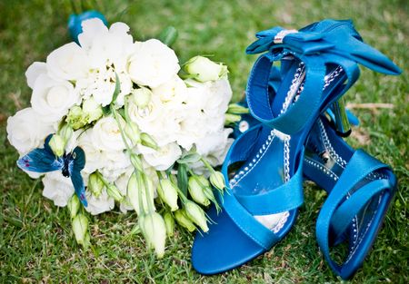 bunched: Blue shoes & Bunched white roses on green grass Stock Photo