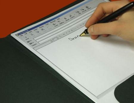 Hand writes e-mail on the sheet of paper Stock Photo