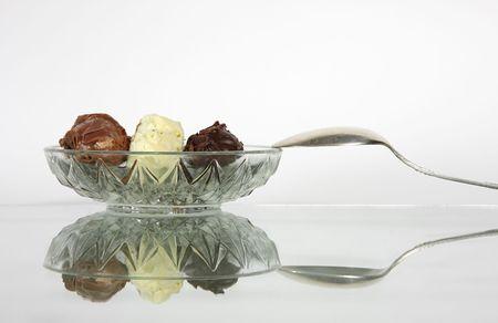 close-ups of flaked chocolate truffles and teaspoon Stock Photo - 2600902