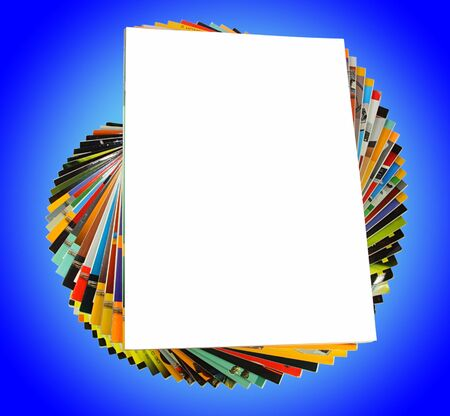 Pile of magazines isolated on blue background