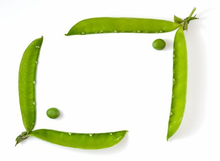 Frame made of green pea and pod isolated on white Stock Photo