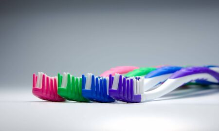 toothcare: close-up of four tooth-brushes in line