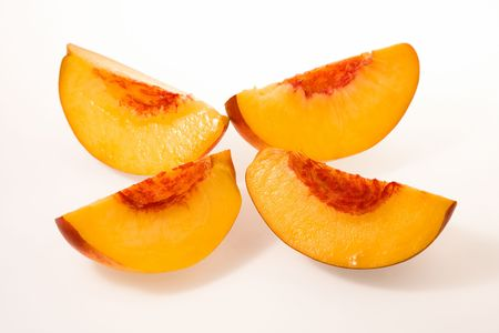 four peach slices on white background Stock Photo