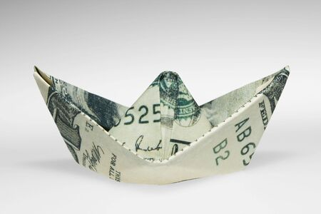 Boat made of dollar note, finance concept. path included. Stock Photo
