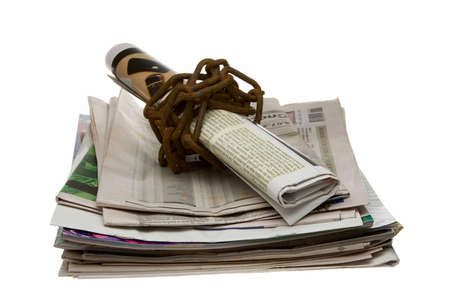 Newspaper wrapped by rusty chain photo