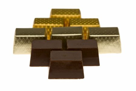 Chocolate candies wrapped in silver and gold foil Stock Photo - 4993128