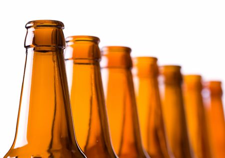 Closeup of empty beer bottles, selective depth of focus on first