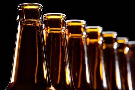 Empty bottles on black, backlit and DOF technique