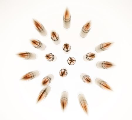 Gun machine cartridges isolated on white and blur treated as projectiles  Stock Photo