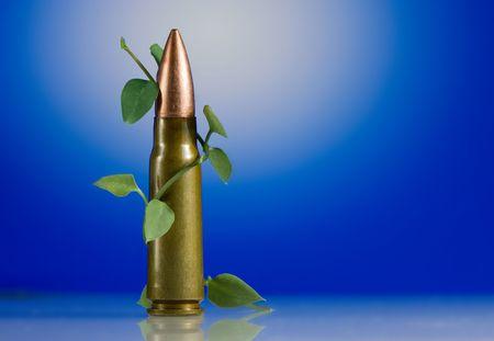 liana: Liana stalk curves around gun machine cartridge
