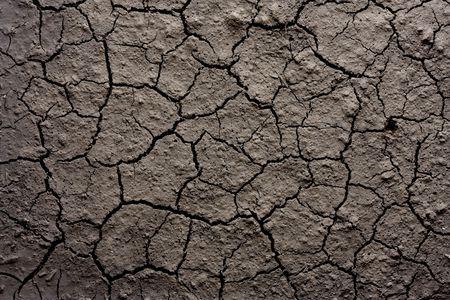 Close-up shot van droge geërodeerde bodem textuur Stockfoto