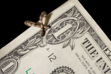 hairy legs: Spiders hairy legs over dollar bank note isolated on black Stock Photo