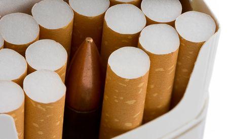 danger box: cartridge in cigarette box as hidden danger of smoking concept