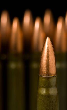Macro of gun machine bullets over dark background photo