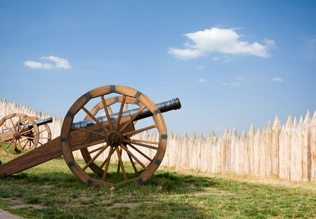 stockade: Old barrels with wooden wheels