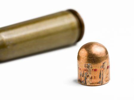 spent: Macro shot of gun bullet and cartridge isolated on white