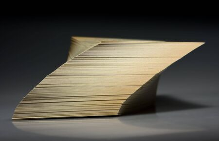 shifted: Shifted and tilted paper stack over black Stock Photo