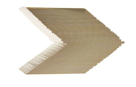 shifted: Close-up of arrow sign formed by cards shifted stack