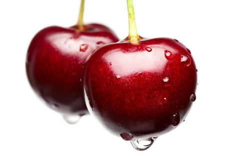 Macro of cherries with water drops isolated on white