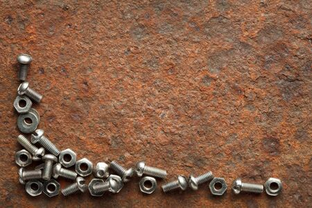 bolts and nuts: Bolts and nuts on rusted iron plate with copy space for text
