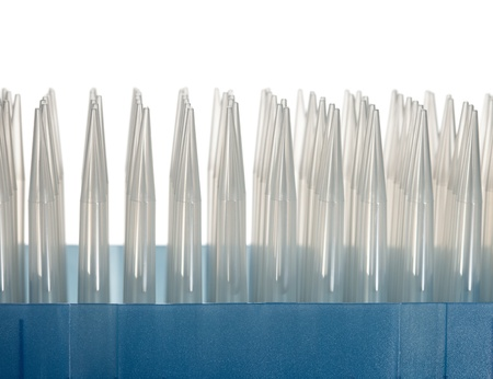 Macro of disposable tips for automatic laboratory pipette isolated on white photo