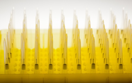science tips: Pack of new tips for automatic pipette over white background