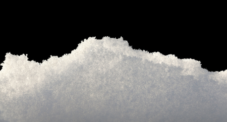 Closeup of snowbank isolated on black
