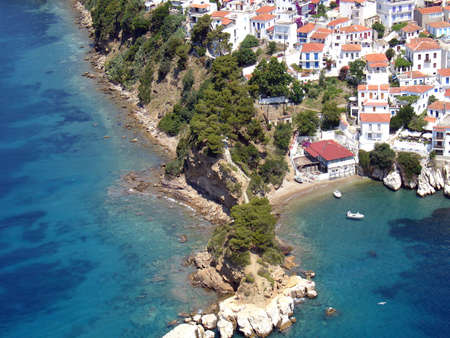 Aerial view of a Greek island village and cape