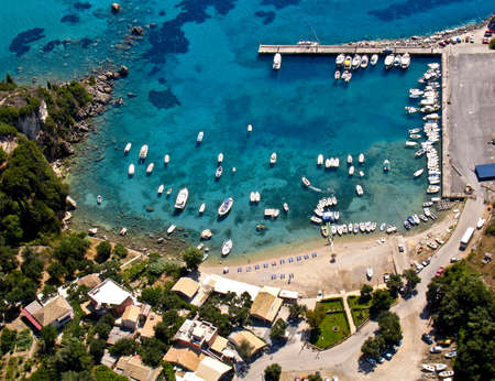 Paleokastritsa port in Corfu, aerial view Stock Photo