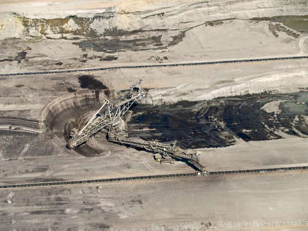 Large excavator in coal mine, aerial view Stock Photo
