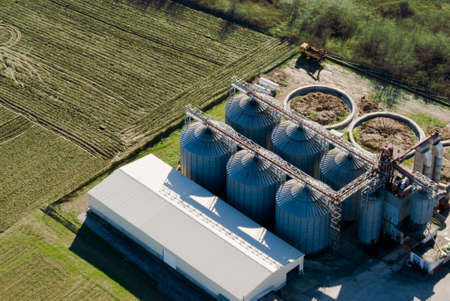 Tower silos and storage facility, aerial view Stock Photo