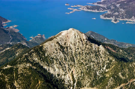 Rocky mountain top near lake, aerial view