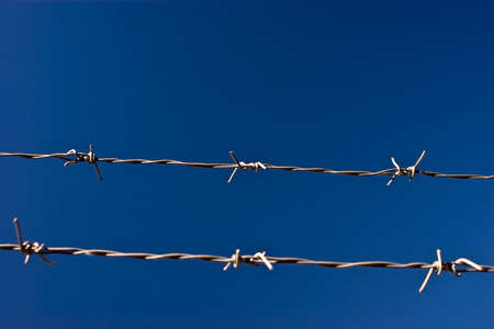 Barbed wire against sky Stock Photo - 4543816