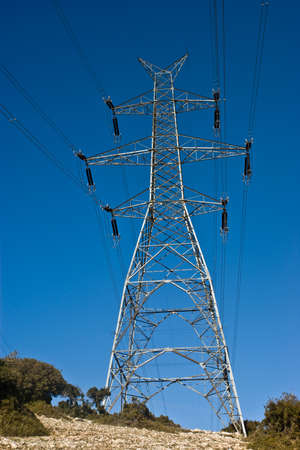 High voltage power line and tower. Stock Photo