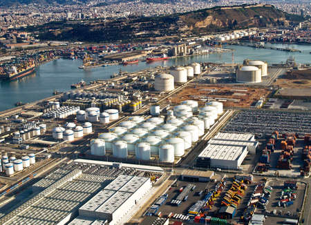 Gas tanks at the port of Barcelona, Spain, aerial view Stock Photo