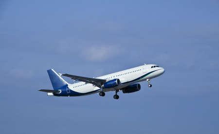 airplane wing: Modern passenger jet airplane at take off Stock Photo