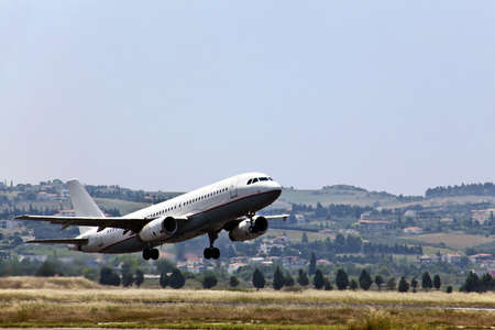 Modern passenger jet airplane landing at urban airport.