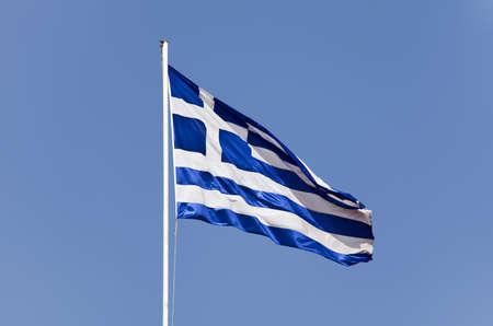 The Greek flag waving in pole photo