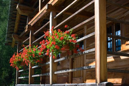 detail of wooden balcony of walser house on italian alps, Piedmont