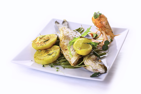 roasted sea bass with garlic, roasted beans and rosemary potatoes